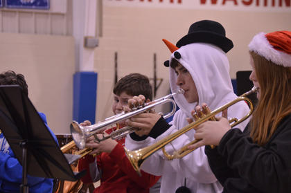 Members of the Washington County High School band perform during the North Wasghinton School's Christmas Band Concert.