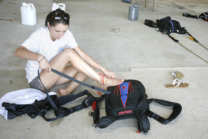 Brooke Minnich, of Louisville, helped pack parachutes on Friday at Arnold's Airport in Washington County.