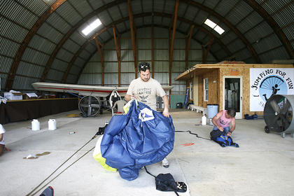 Barnett helped pack and inspect parachutes at Arnold's Airport on Friday.