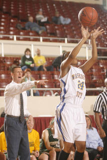 Freshman Riquel Logan drained a three in front of the Owensboro Catholic bench on Wednesday.