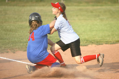 Top, Catelyn Norris and Chasity Warner collided at third base during a softball game.