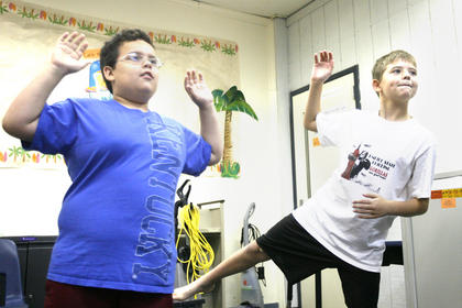 German Gaona and Bryce Smith played a game on Xbox Kinect to practice mobility.