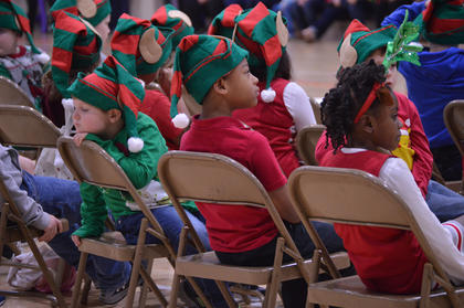 A young member of the Washington County Elementary School's Christmas Program enjoys a short rest before the start of the annual program on Thursday, Dec. 13.
