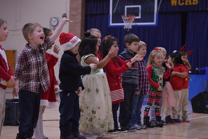 Preschool students from Washington County Elementary School perform a song about Santa Claus during the school's Christmas program.