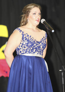 Brittany Greenwell talks to the judges from the stage during her performance.