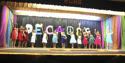 """The girls wave to the audience before retiring for intermission. The theme of Washington County's 2016 Distinguished Young Woman competition was """"Decades."""""""