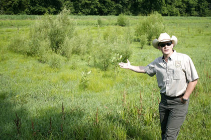 Wes Little, a Fish and Wildlife Department expert with the local NRCS office, explained the benefits of wetlands.