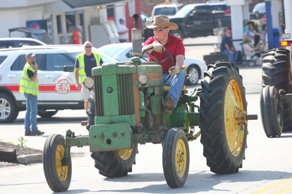 Hunter Bobblett drives a John Deere tractor during the parade down Main Street.